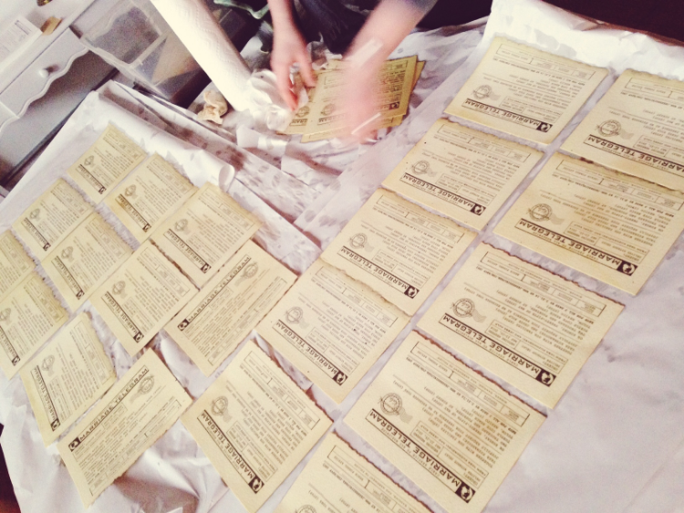 Emily tea-stains invitations that were designed to look and feel like an old telegram.
