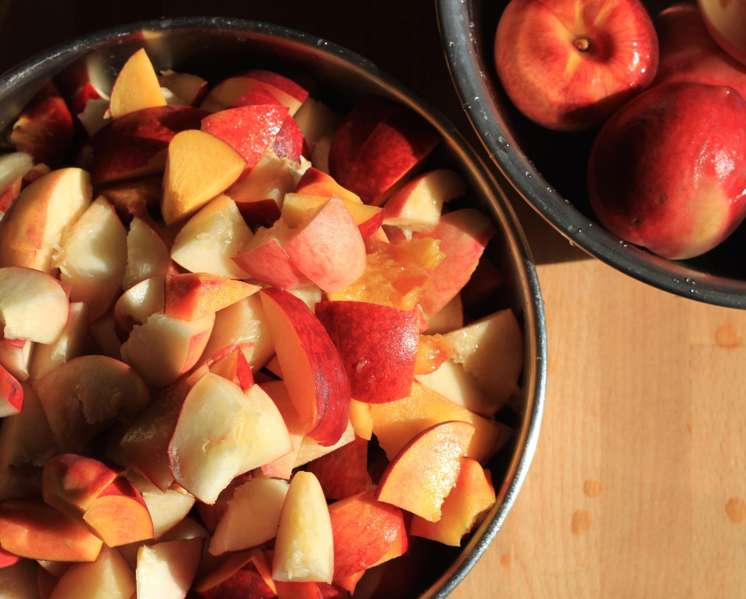 cutting up peaches for a summer peach shrub
