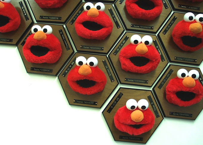 detail of  N-Trophy   (2003) heads of 63 previously owned Tickle Me Elmos mounted on trophy plaques and re-auctioned on eBay