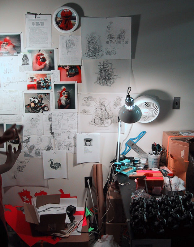studio at the MIT Center for Advanced Visual Studies showing   The Anatomy of the Furby   (2000) in process and images from   The Codex of Reflection Loop   (2001)