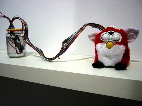 detail of  Where Am I?   (2001) modified Furby, custom electronics, glass jar and cardboard box firmwear engineering by Steven Gray private collection