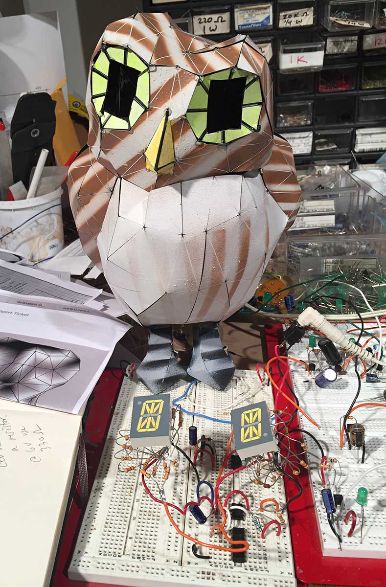 Paper owl looking onto its electronic eye circuit, 2018