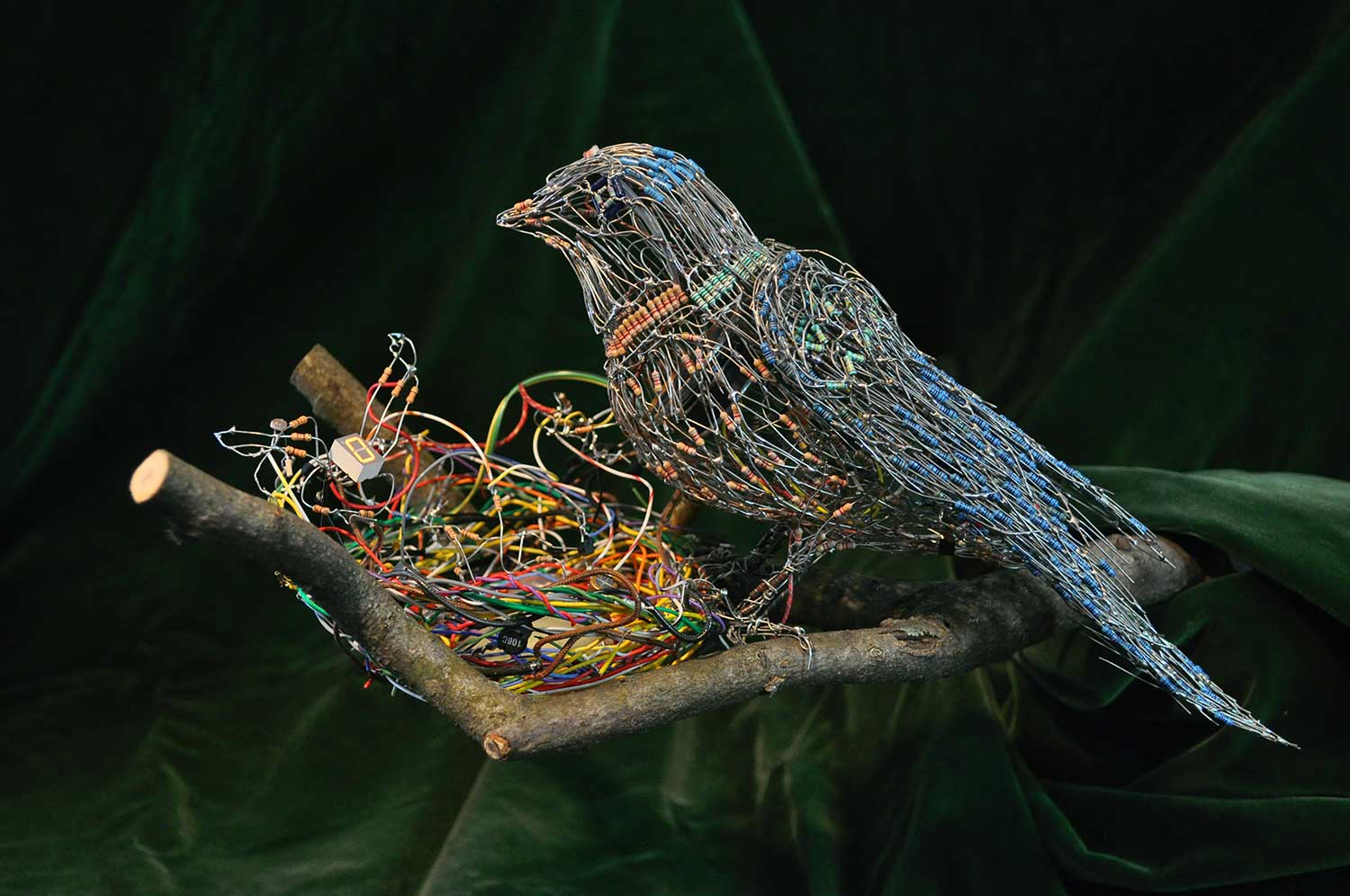 Mama Bird with Baby, 2018. Analog electronics and wooden branch
