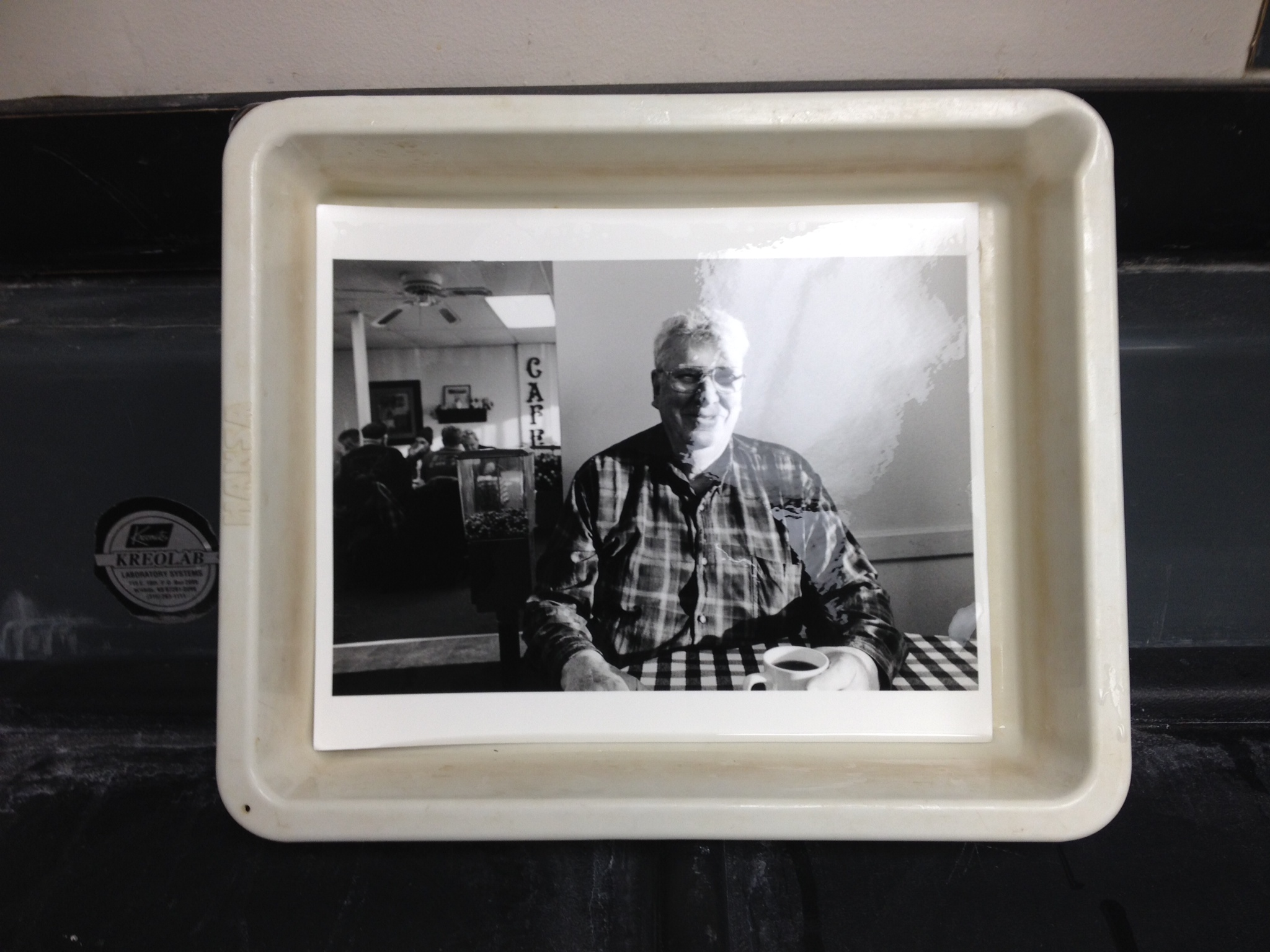Work print of Dennis, having coffee at Ma's Cafe, in Plainview, Minnesota on Halloween morning, 2014.