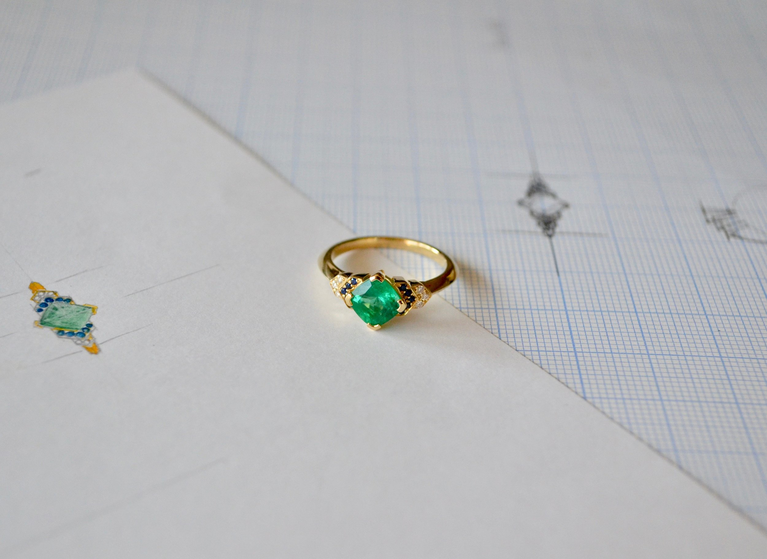 Spanner & Wingnut bespoke engagement ring || Cushion Cut emerald with sapphires & diamonds