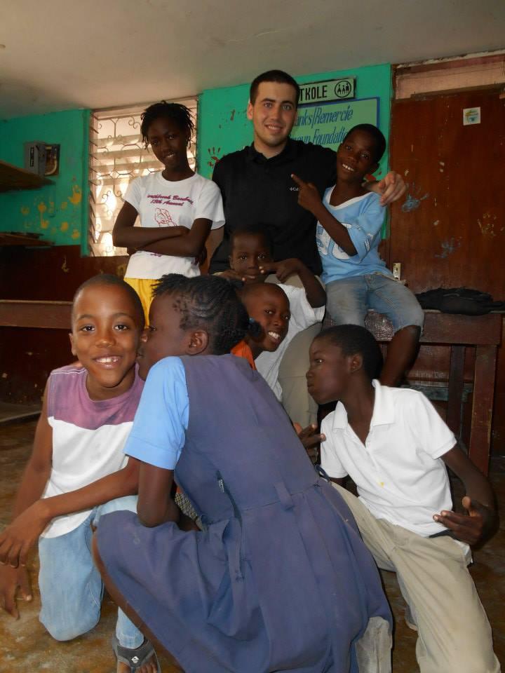 Alex Henning, HTF Summer Intern, hanging out with kids at Tetkole.
