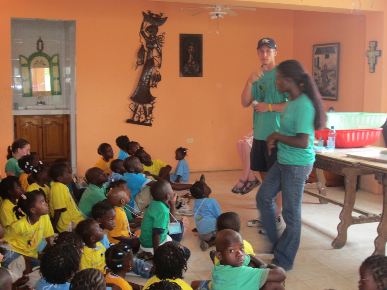 Campers in Science learning about hygiene with the help of Dany Selme, a HELP alumni.  Fet Bondye Bo Lanme 2011.