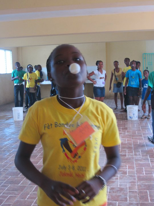 Spoon/ping pong ball relay races in Games at Fet Bondye Bo Lanme 2011. We're looking forward to even MORE fun and games at Fet Bondye Bo Lanme 2012!