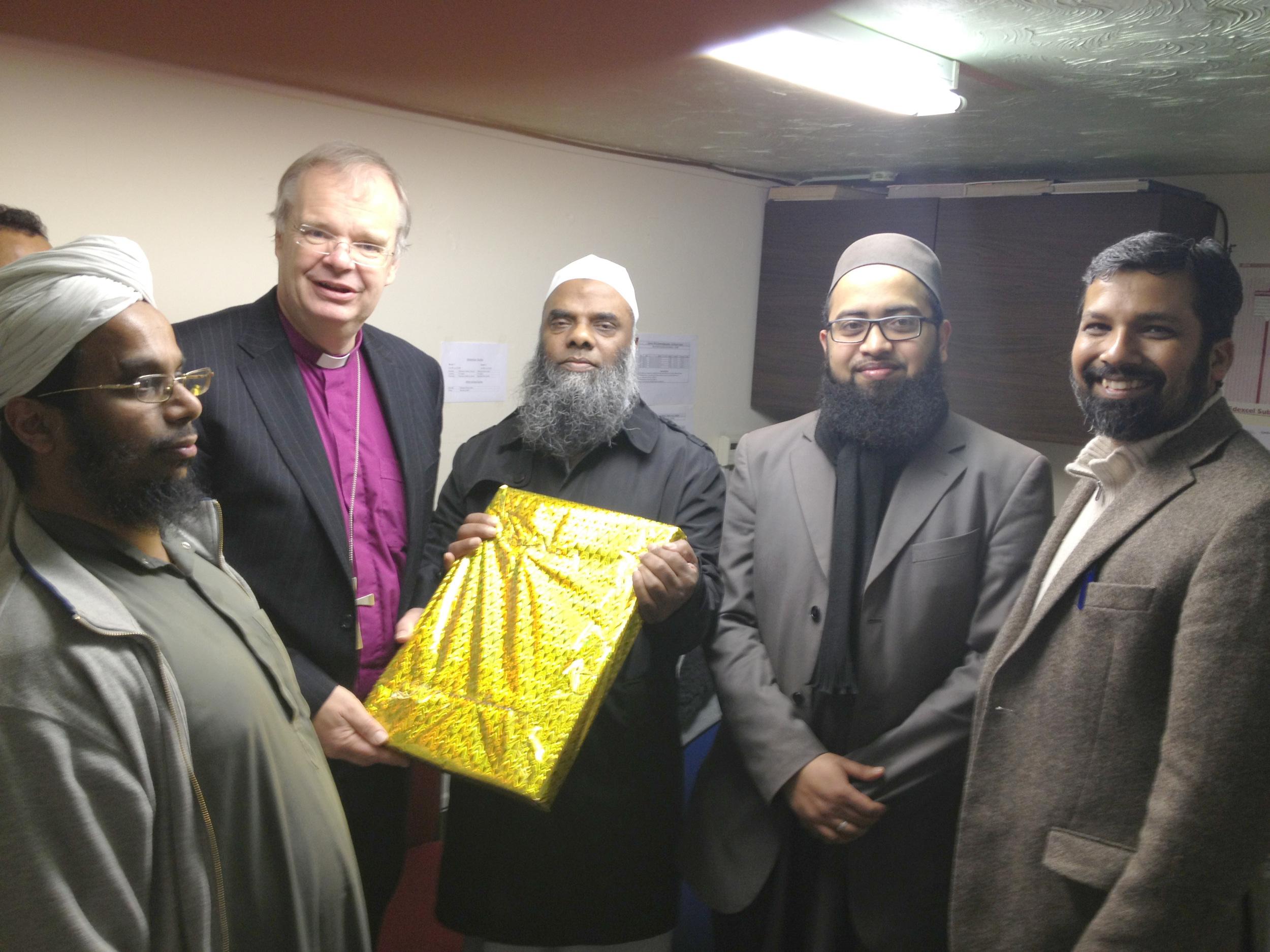 Bishop Richard being felicitated at the Bury Park Jamia Masjid.jpeg