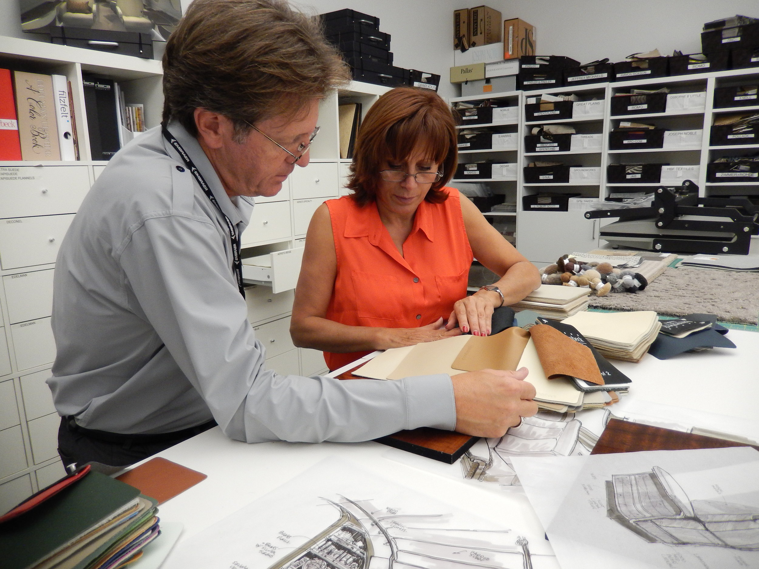 It's all in the details. - Master designer Edward Sotto reviews his design sketches directly with manufacturers (seen here at Embraer Design Studio) and aviation contractors to ensure that in the end, everything