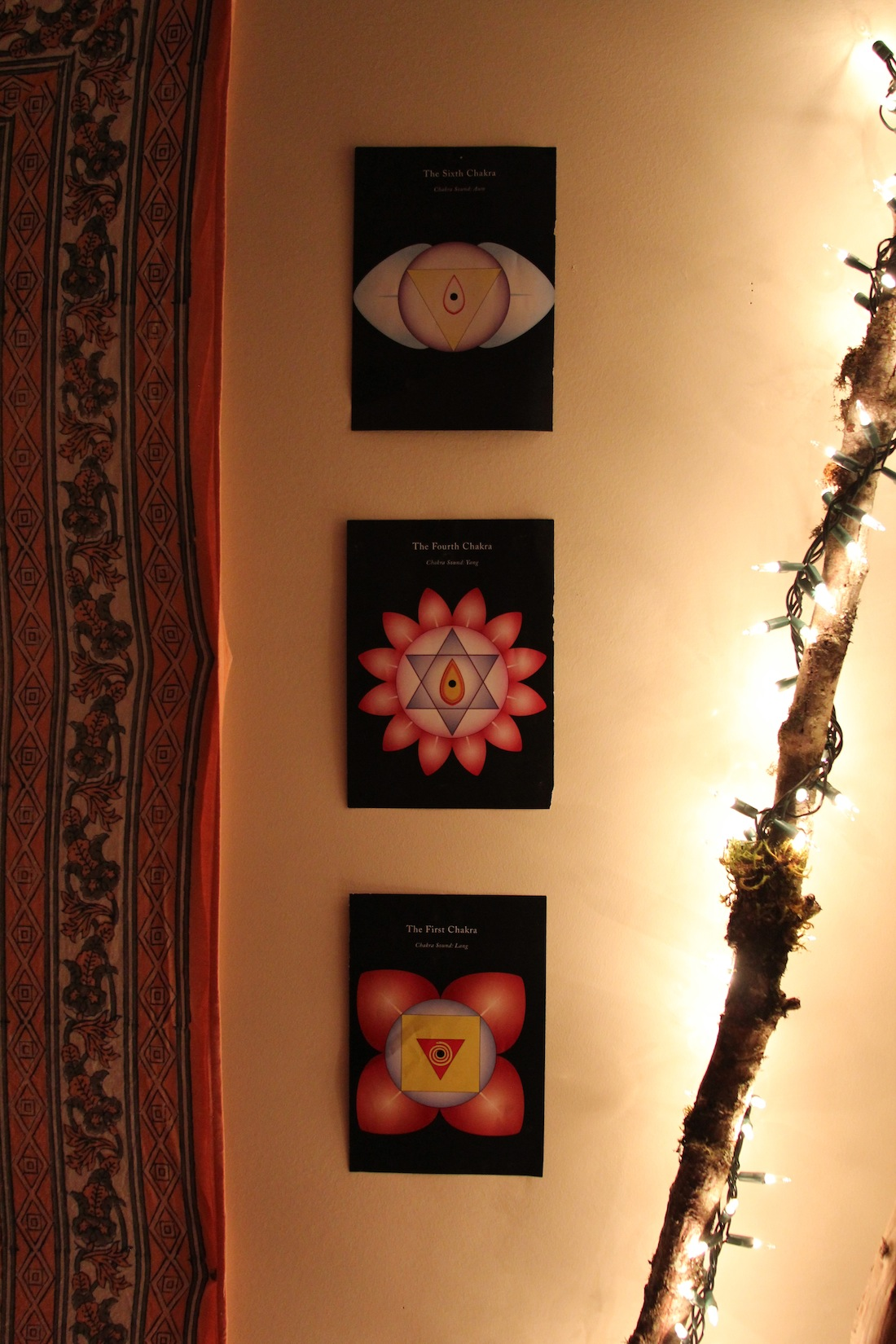 The symbols for the root, heart, and third eye chakras add power to the space