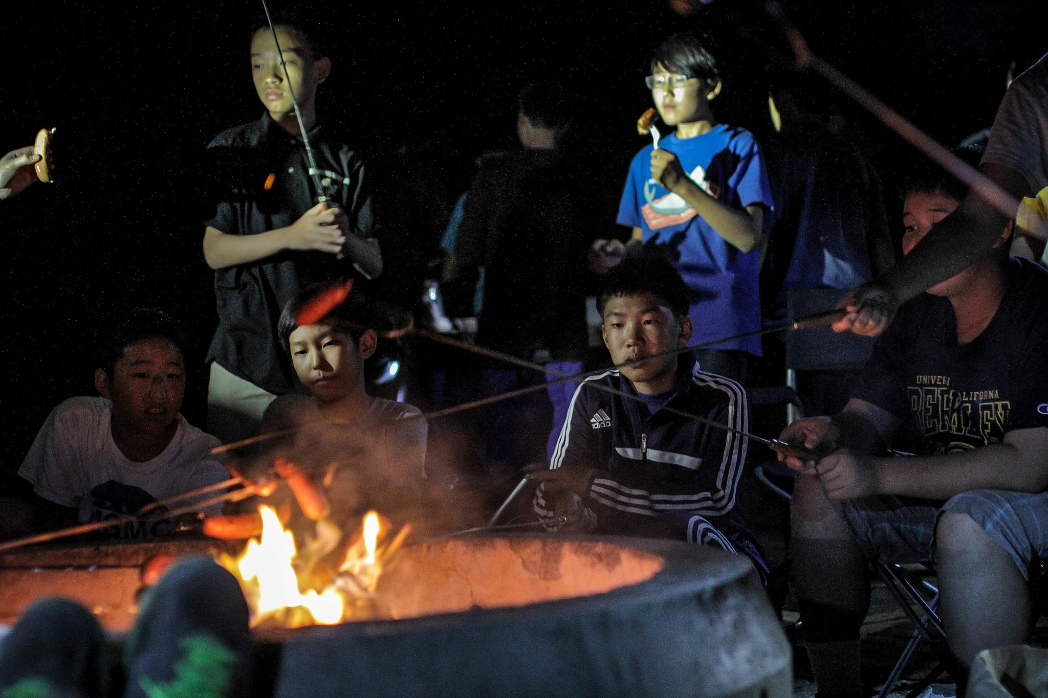The boys also heard scary stories, but we spent most of our time munching on delicious food roasted over an open fire. Late at night, we played board games inside our tents with just a small lantern as our source of light. It felt like we were connecting with nature...sort of.
