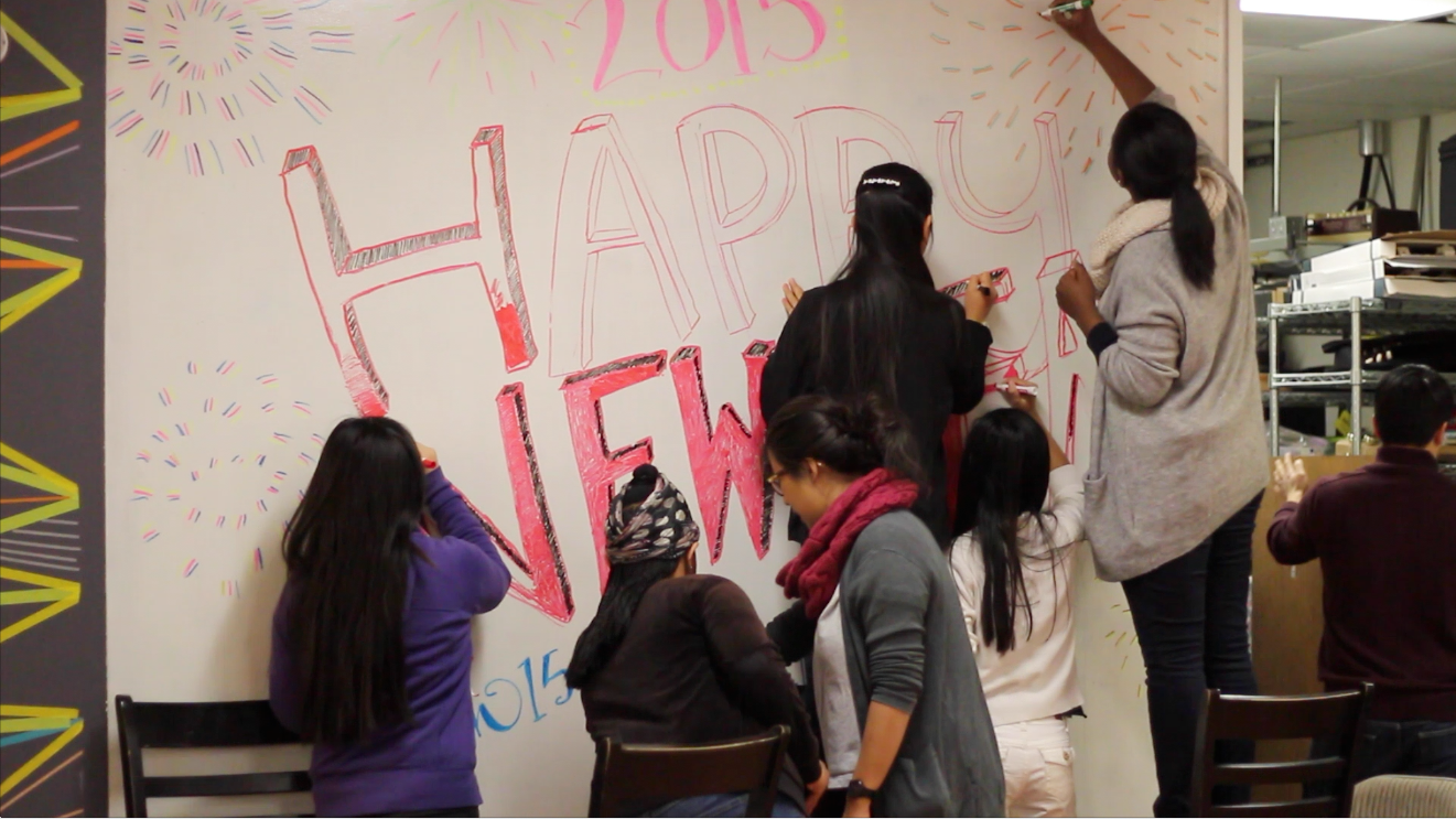 Here, the whiteboard teammade a new mural celebratingthe New Year! HAPPY NEW YEAR!