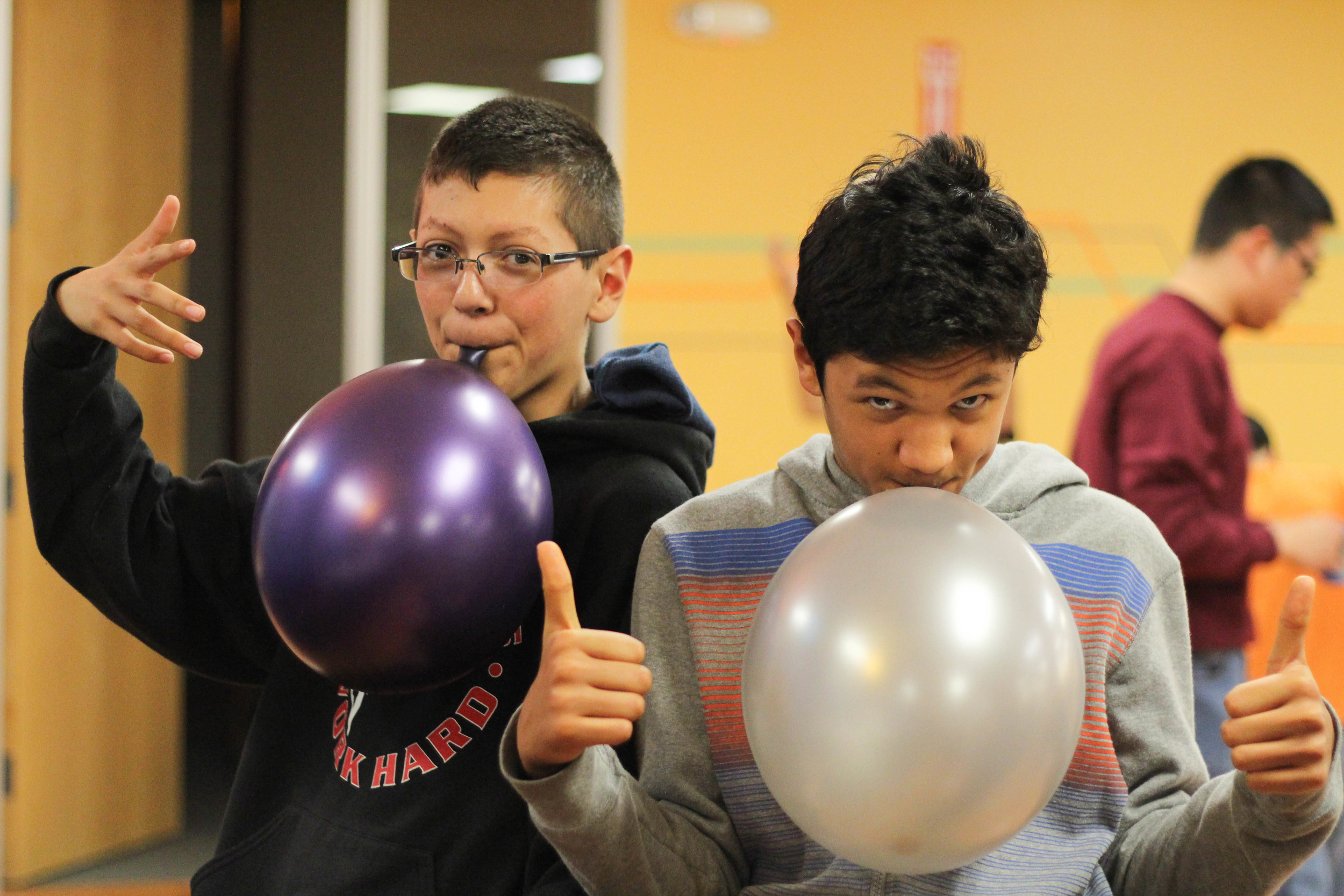 Afterwards, we played a bunch of balloon games in the gymand in our middle school room! The boys were particularly helpful in preparing allthe balloons for us. Thanks guys!