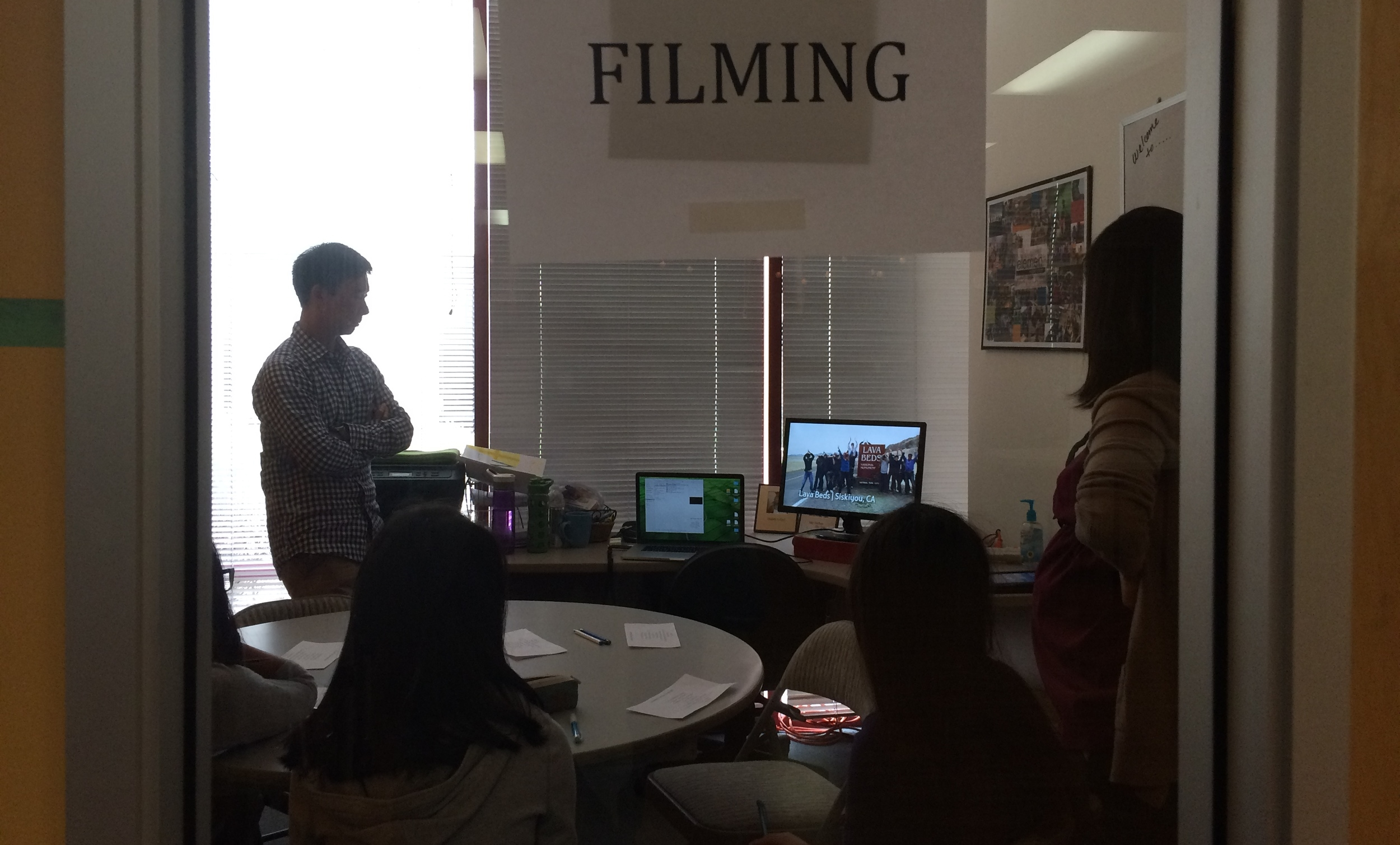 The Video team watching good examples of videos as they brainstorm ideas for some video trailers.