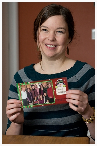 Betsy holds a picture of her family, who also benefit from a family gift exchange and her gifts of service.