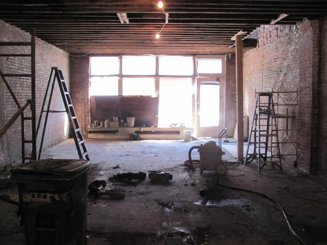 This shot shows the space right after the stairwell to the upstairs apartment was removed. It really opens up the front of the space.