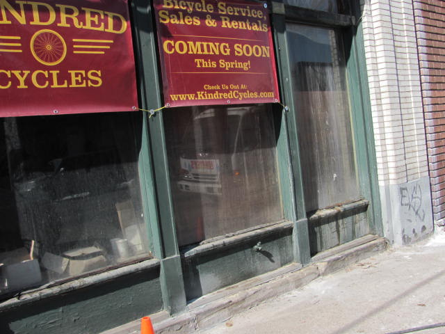 The storefront is old and dirty. It's time to get some paint up.