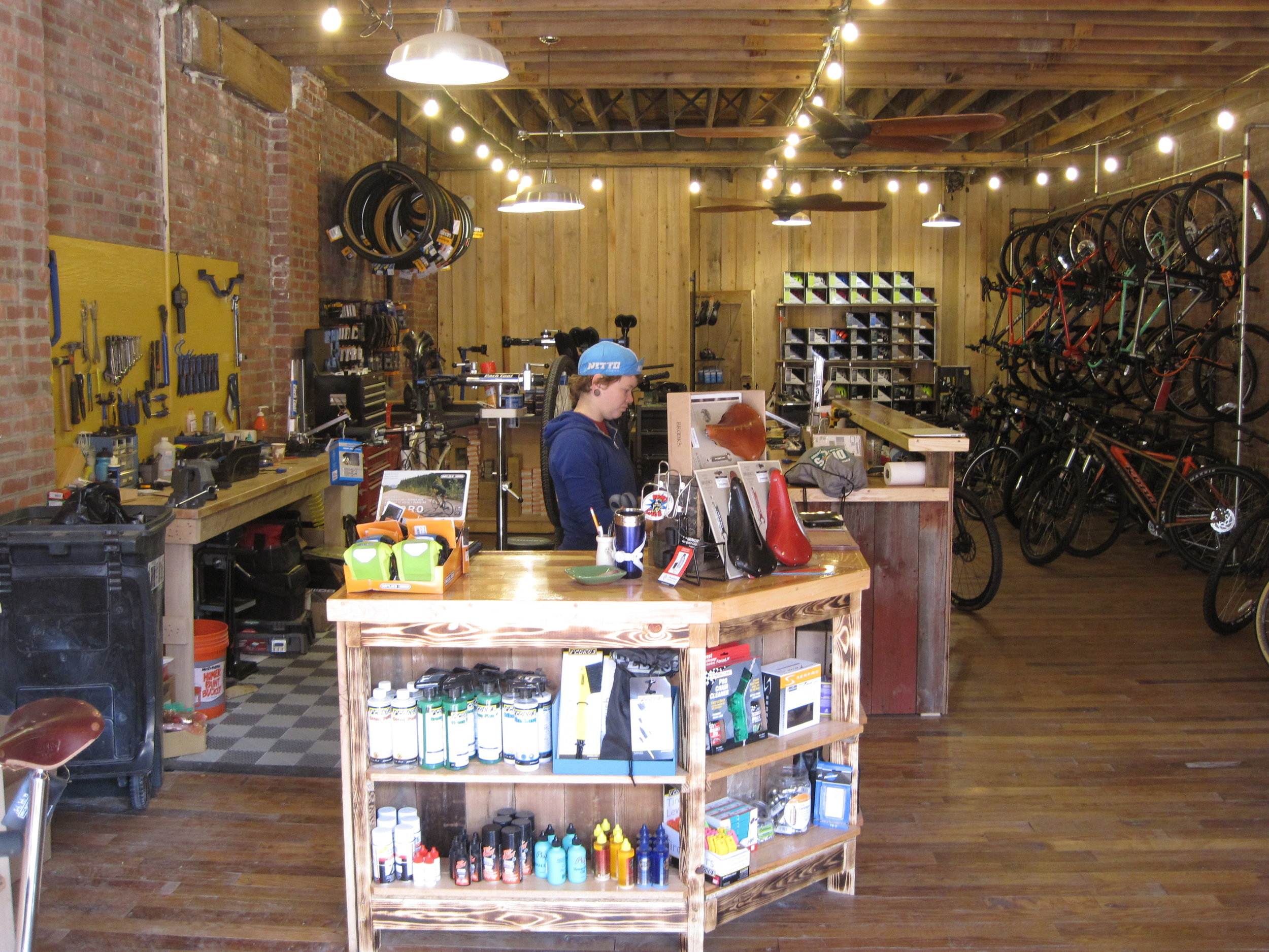 Probably what some of you remember if you haven't been in the shop in a while. Checkout and Service are all together against the left wall as you come in to the shop.