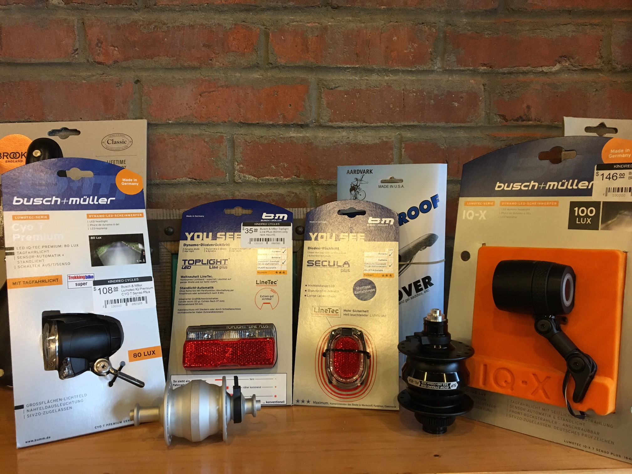 Here are some of the Dynamo products we keep in stock here at the shop.  Most of the lights we carry are from Germany, where until 2013, all bikes over 11kg legally had to have a dynamo lighting systems to be in compliance with the law.  Now battery powered lights are legal but Dynamos still rule the roost in Germany and much of Europe.