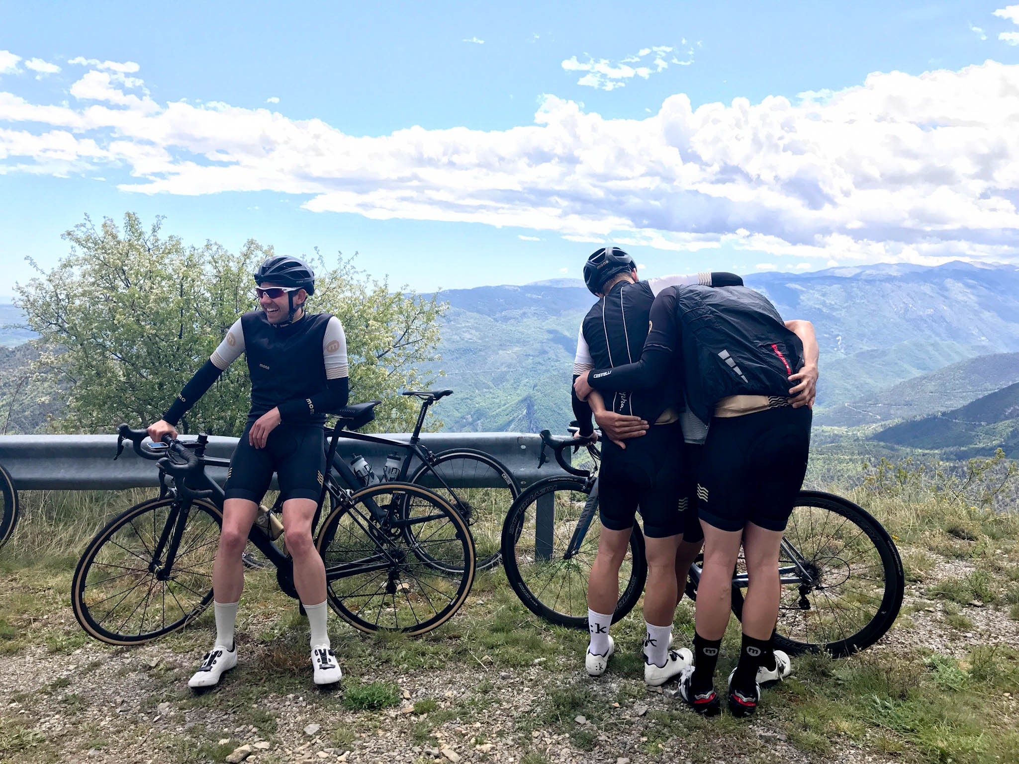 Stay warm on the descent with gilets, arm warmers and by hugging team mates