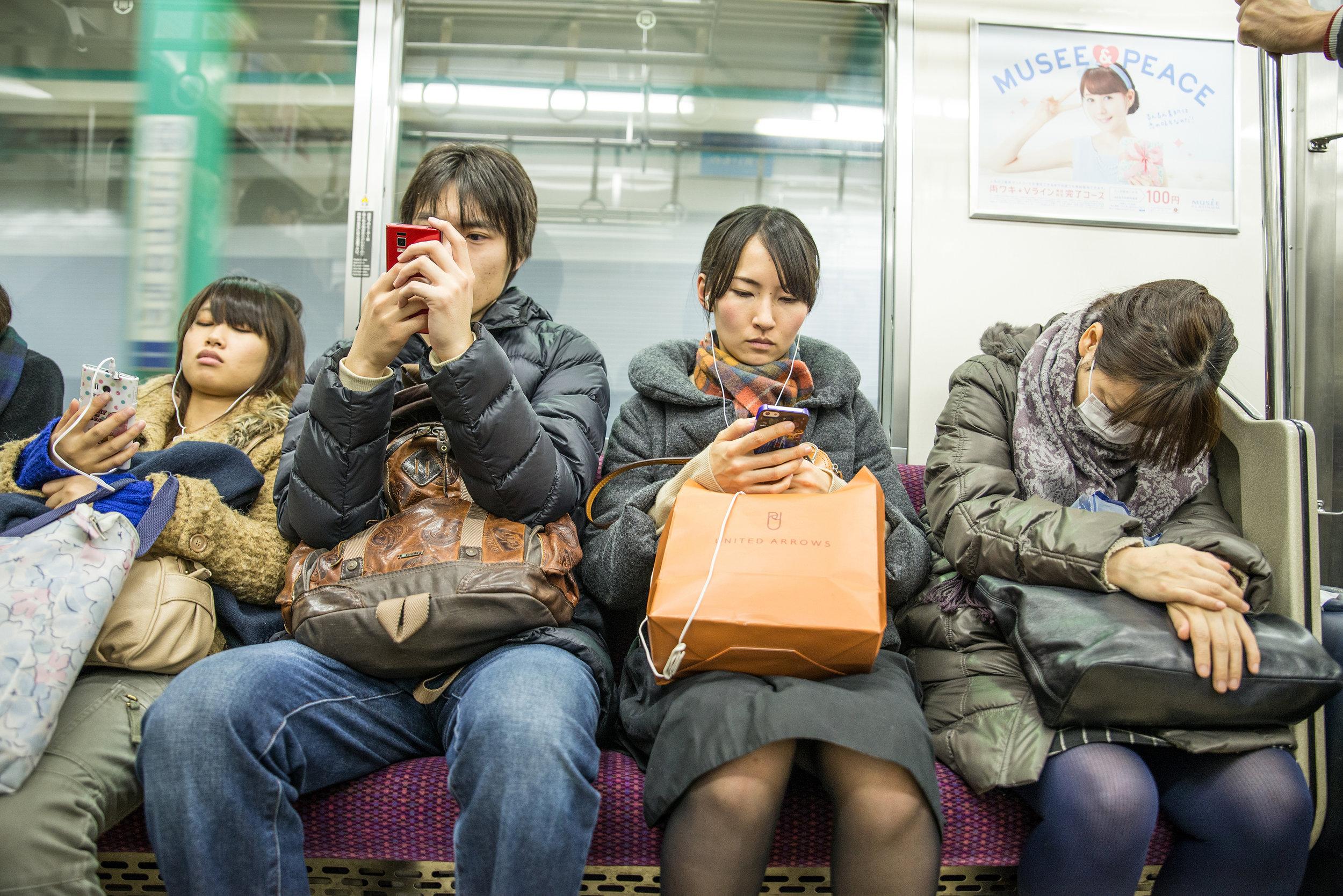 sitting-on-train-in-japan or subway-125dpi.jpg