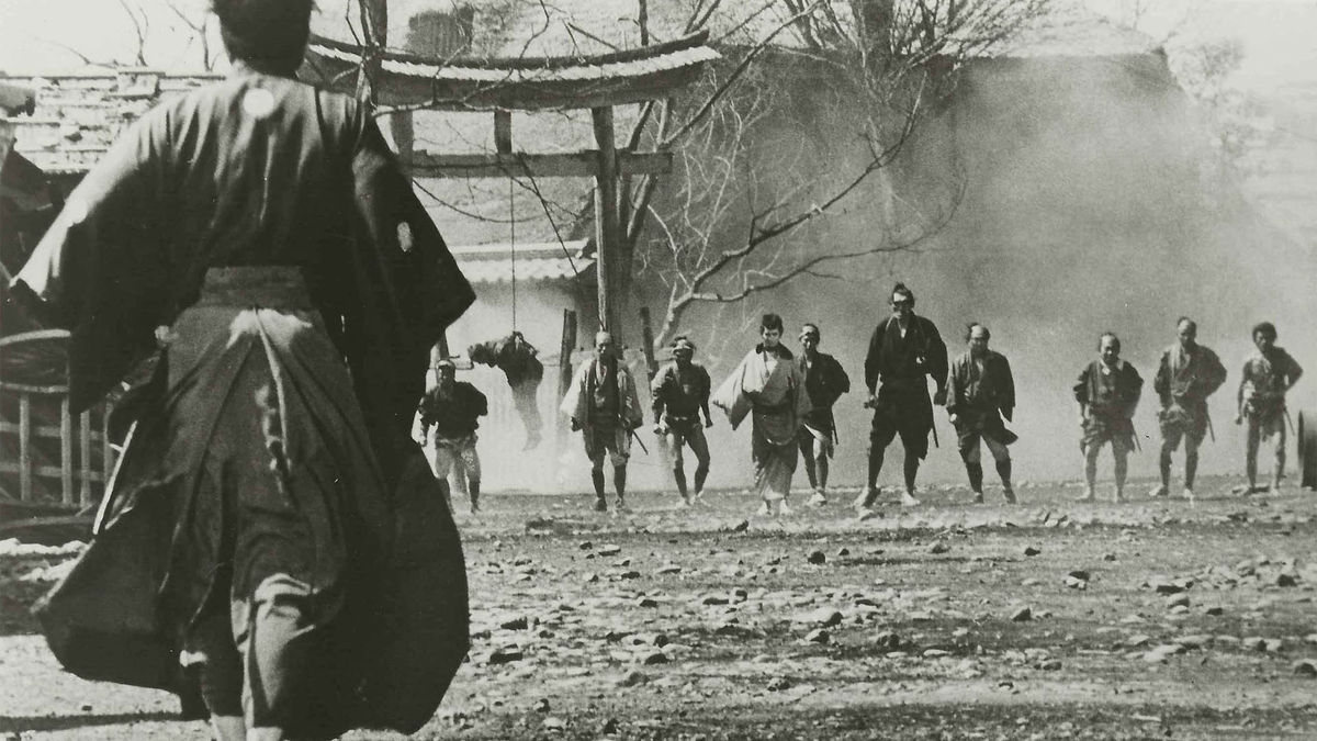 Toshiro Mifune's character, a masterless Samurai (ronin) in Yojimbo (1961) walking toward a gang from one of the two local crime syndicates in the middle of a turf war.