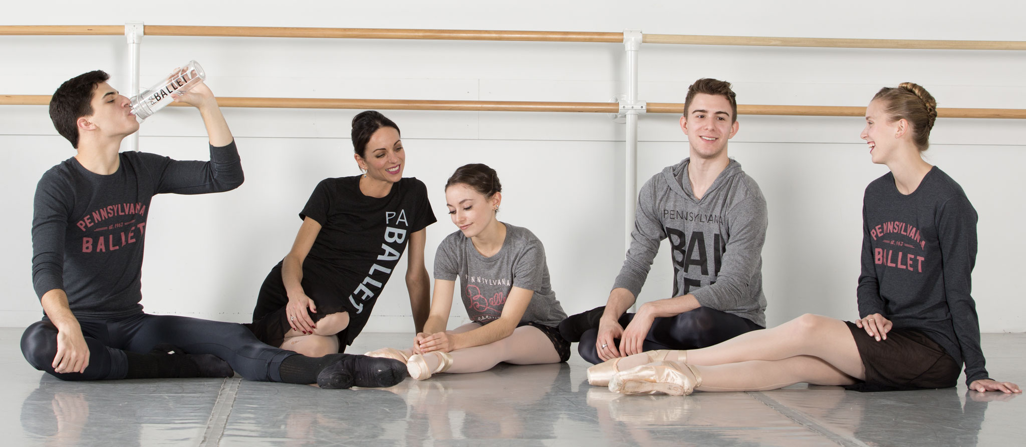 Pennsylvania Ballet dancers stretching