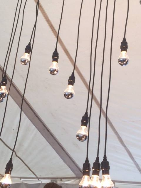 "We had custom ""bedazzlers"" made for the event that  hovered over the bar area. A similar lighting story was suggested in the renderings of the Glass House Sky Loft lobby space."