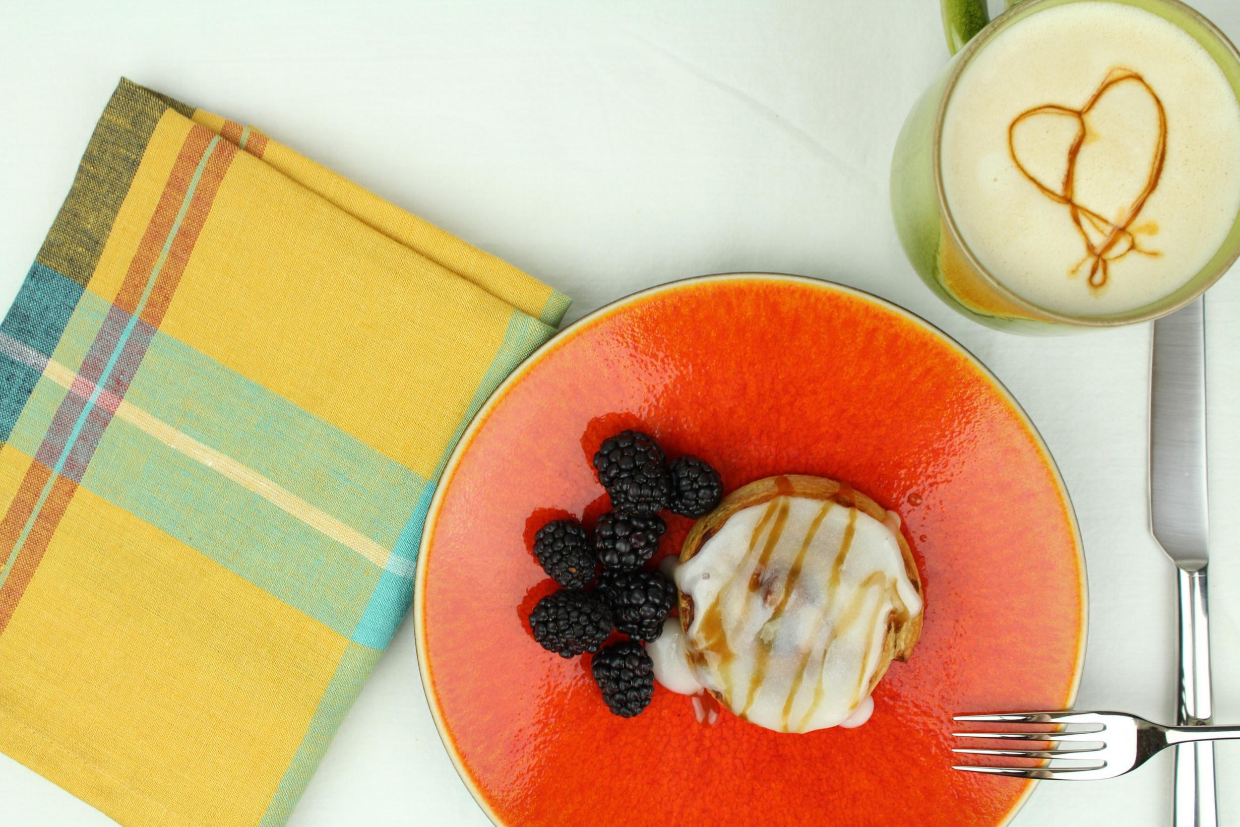 Libeco Indiana linen napkin ,  Jars Tourron dessert plate in Orange ,  Jars Tourron mug in Avocado ,  David Mellor Pride flatware