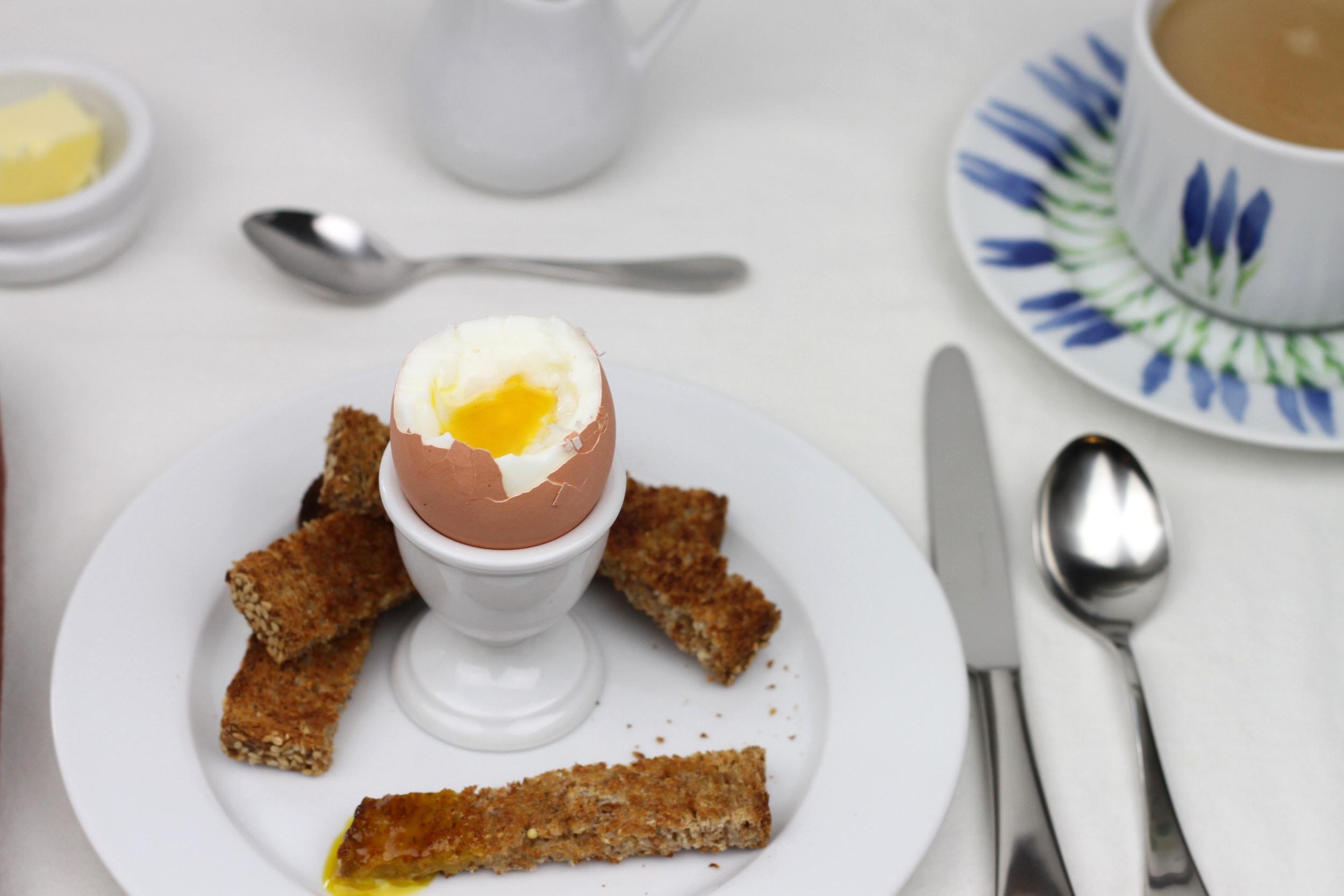 """Pillivuyt  traditional egg cup , Pillivuyt  7 3/4"""" Sancerre plate , Pillivuyt  3 oz Mehun jug , Pillivuyt  butter block ,  David Mellor English flatware , Pillivuyt  Fleur de Provence cup  and  saucer ."""