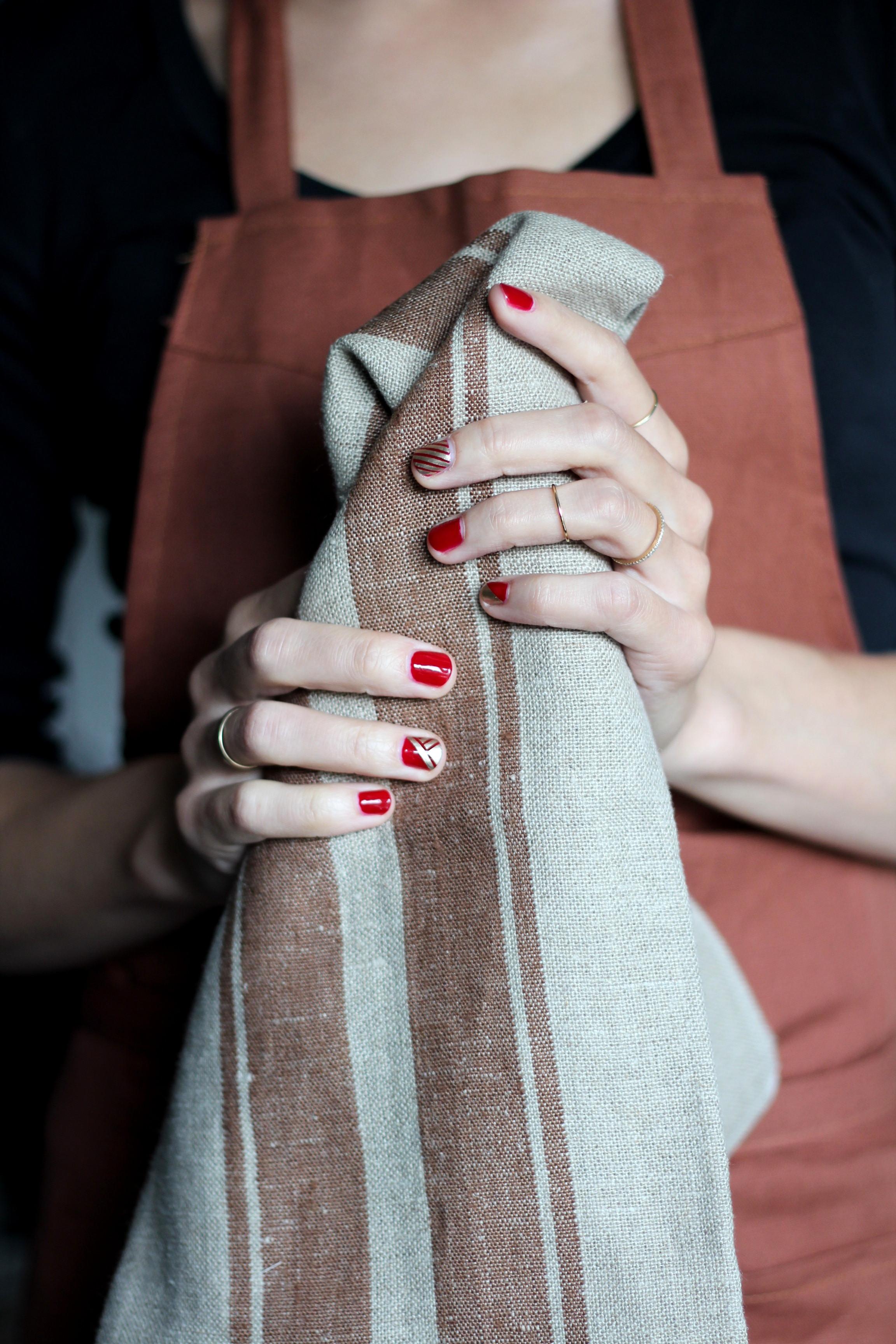 Libeco Home  Bistro Apron , Libeco Home  Grainhall Stripe tea towel . Nails: Essie Good as Gold over Revlon Velvet Rope.