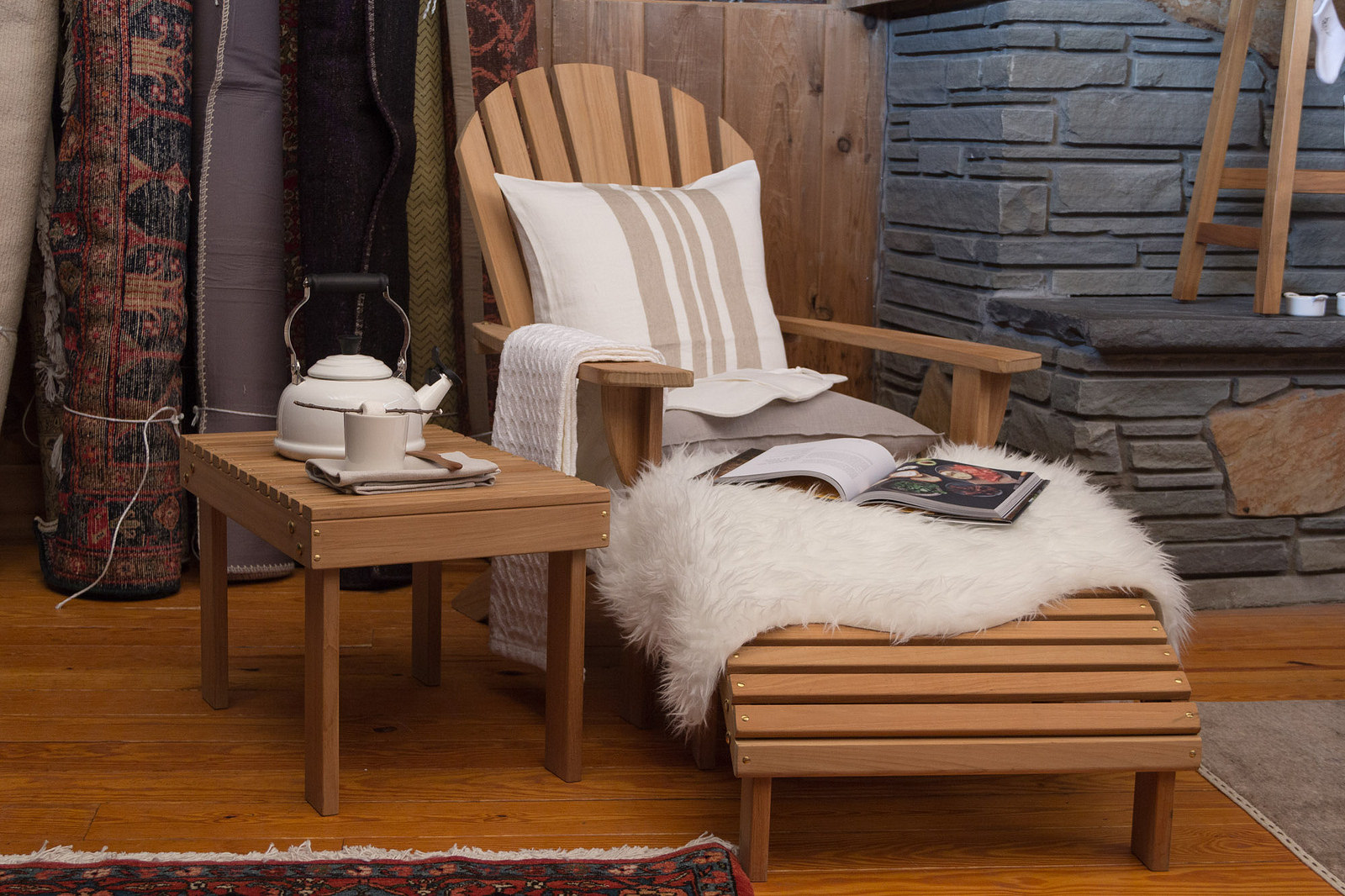 Barlow Tyrie Adirondack  teak armchair,  Libeco Home Serengeti throw pillow ,  Le Creuset whistling kettle ,  Brahms Mount baby blanket