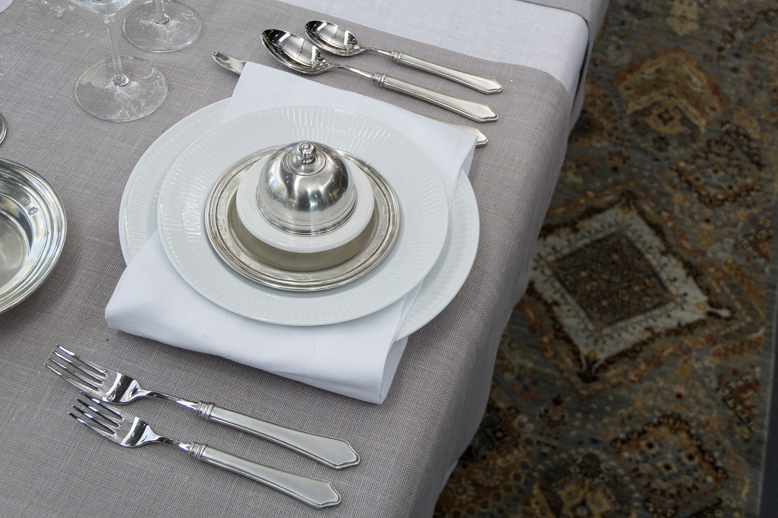 Match Pewter  Violetta flatware , rug provided and selected by  Gregorian Oriental Rugs