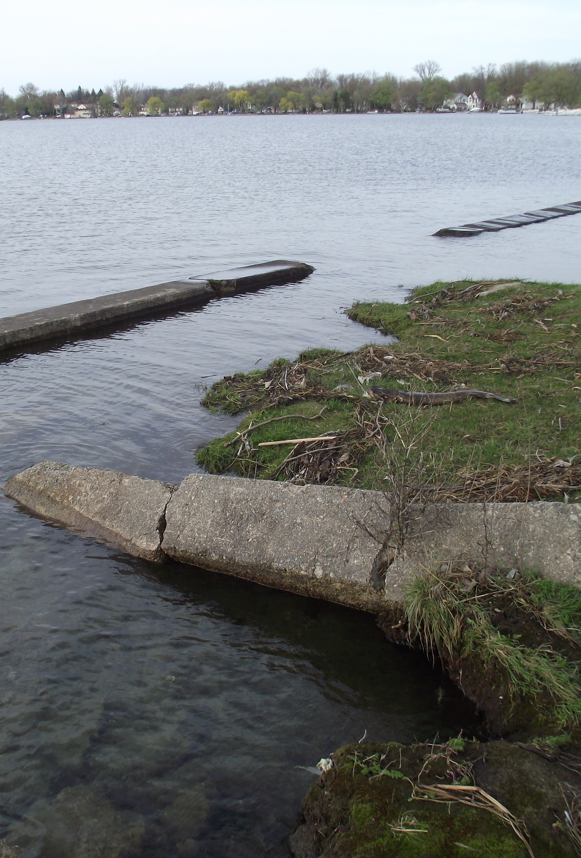 Erosion & failed seawall before