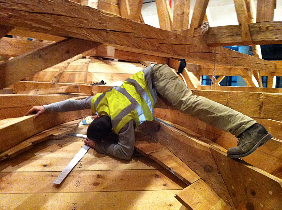 Adjusting the ceiling panels in timber frame dome