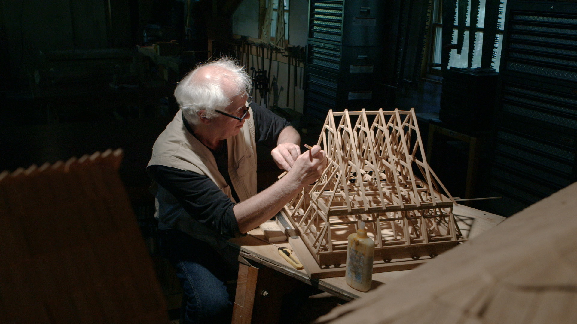 Still 9:  Rick Brown puts finishing touches on the Gwoździec roof model.