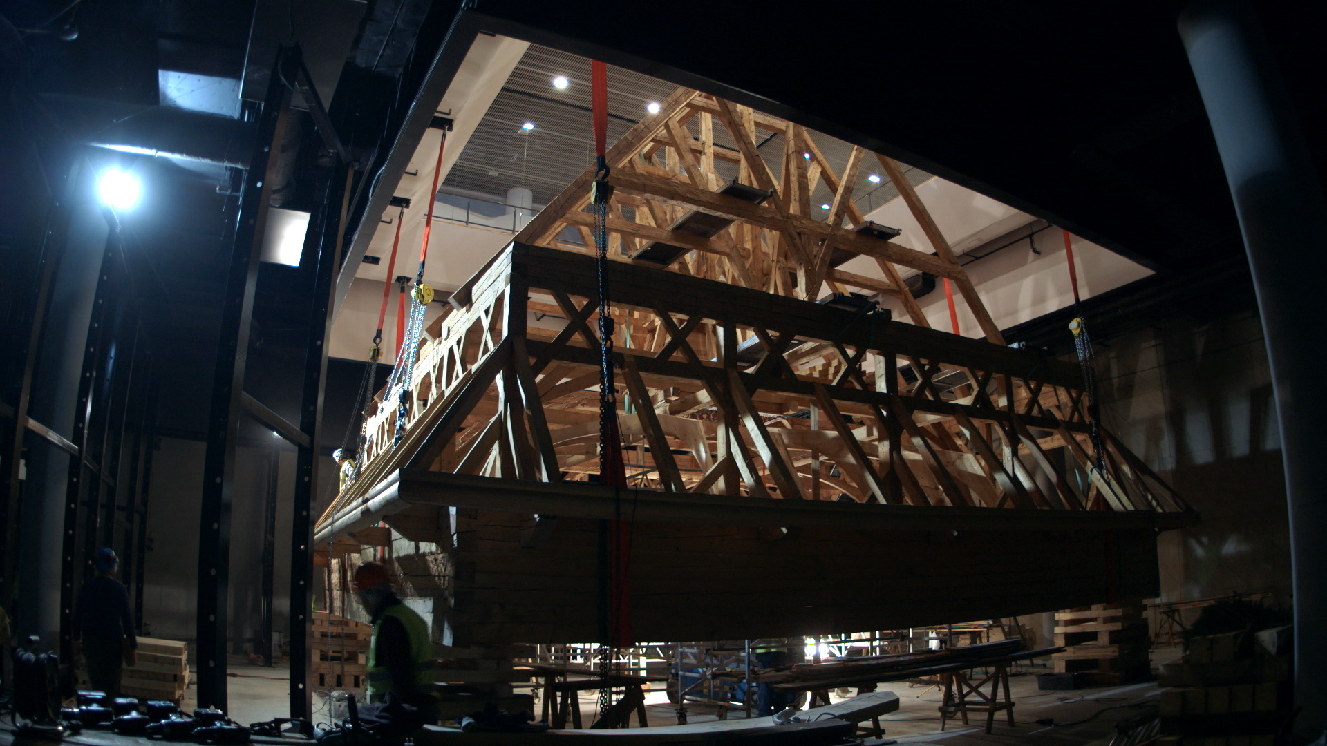 Still 43:  The Gwoździec roof structure is hoisted into place using many chainfalls.