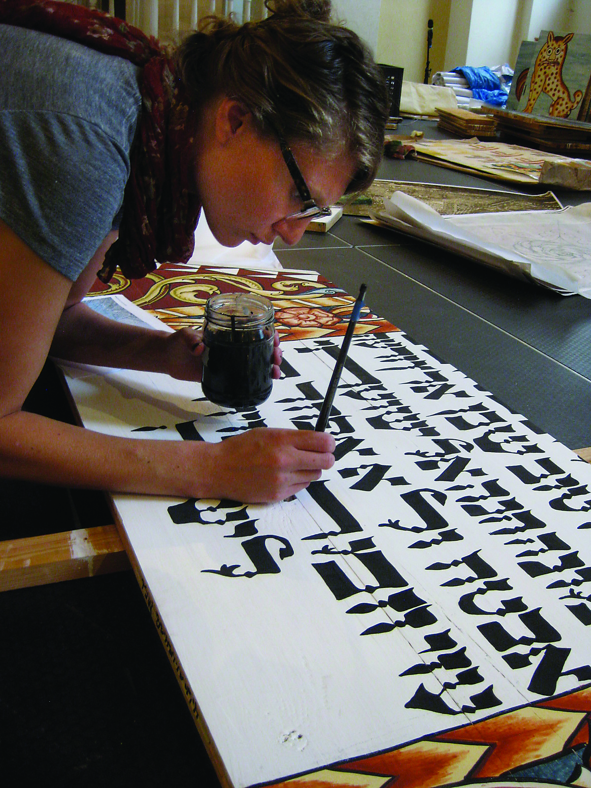Ariel Rosenblum, who devoted many years of preparation to become the project's Hebrew calligraphy expert, paints the Hebrew text on a pendentive.