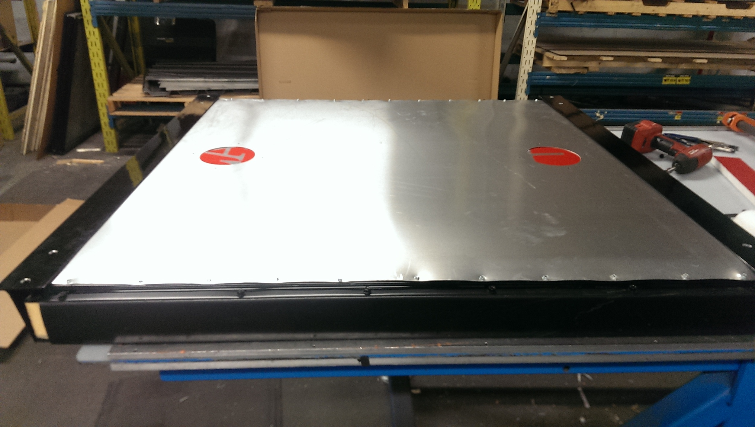 Aluminum plate with 5 inch holes for penetration. Mounts attached for fit.