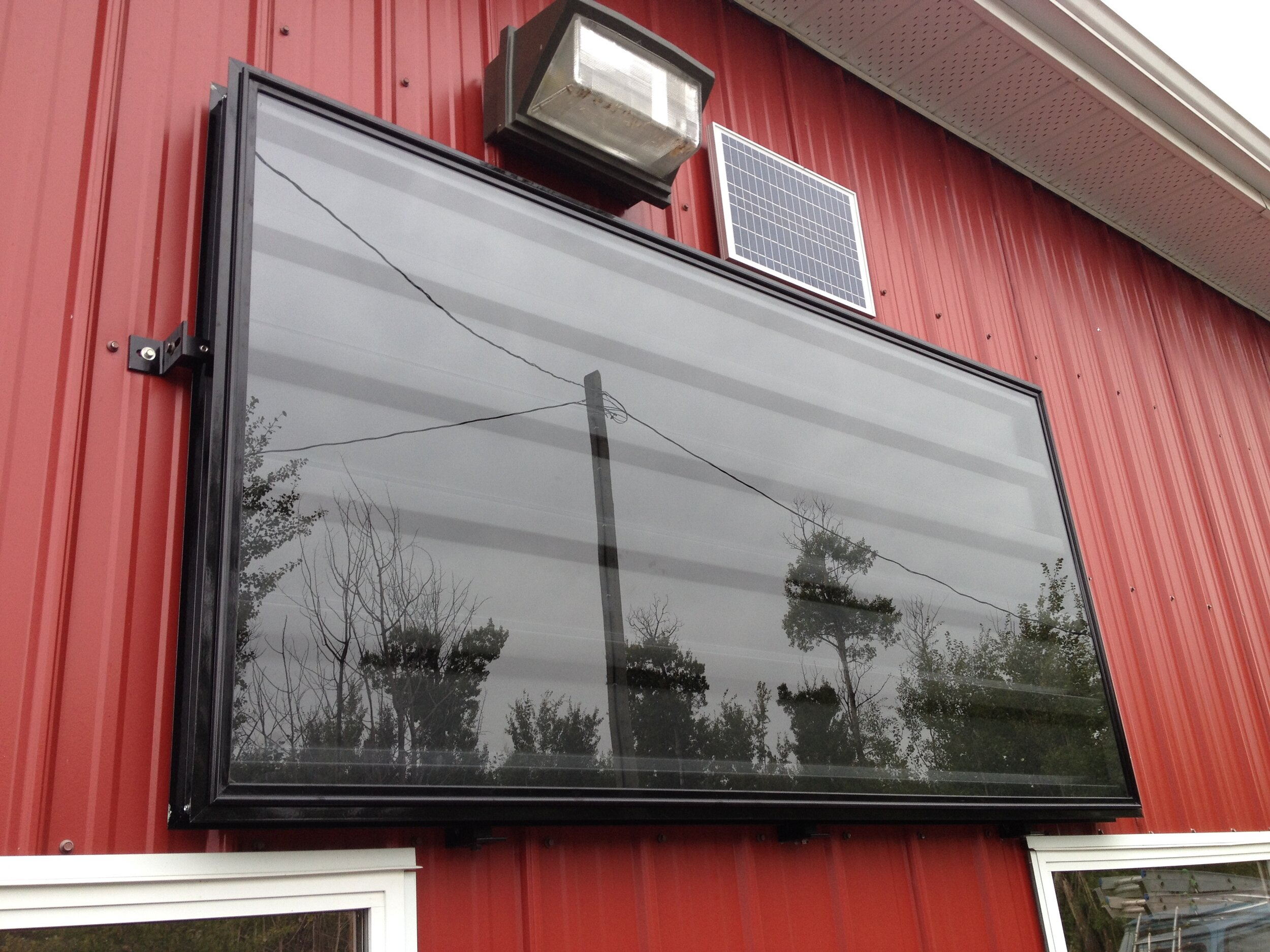 Wall Mounted Collector with 20 Watt PV panel.JPG
