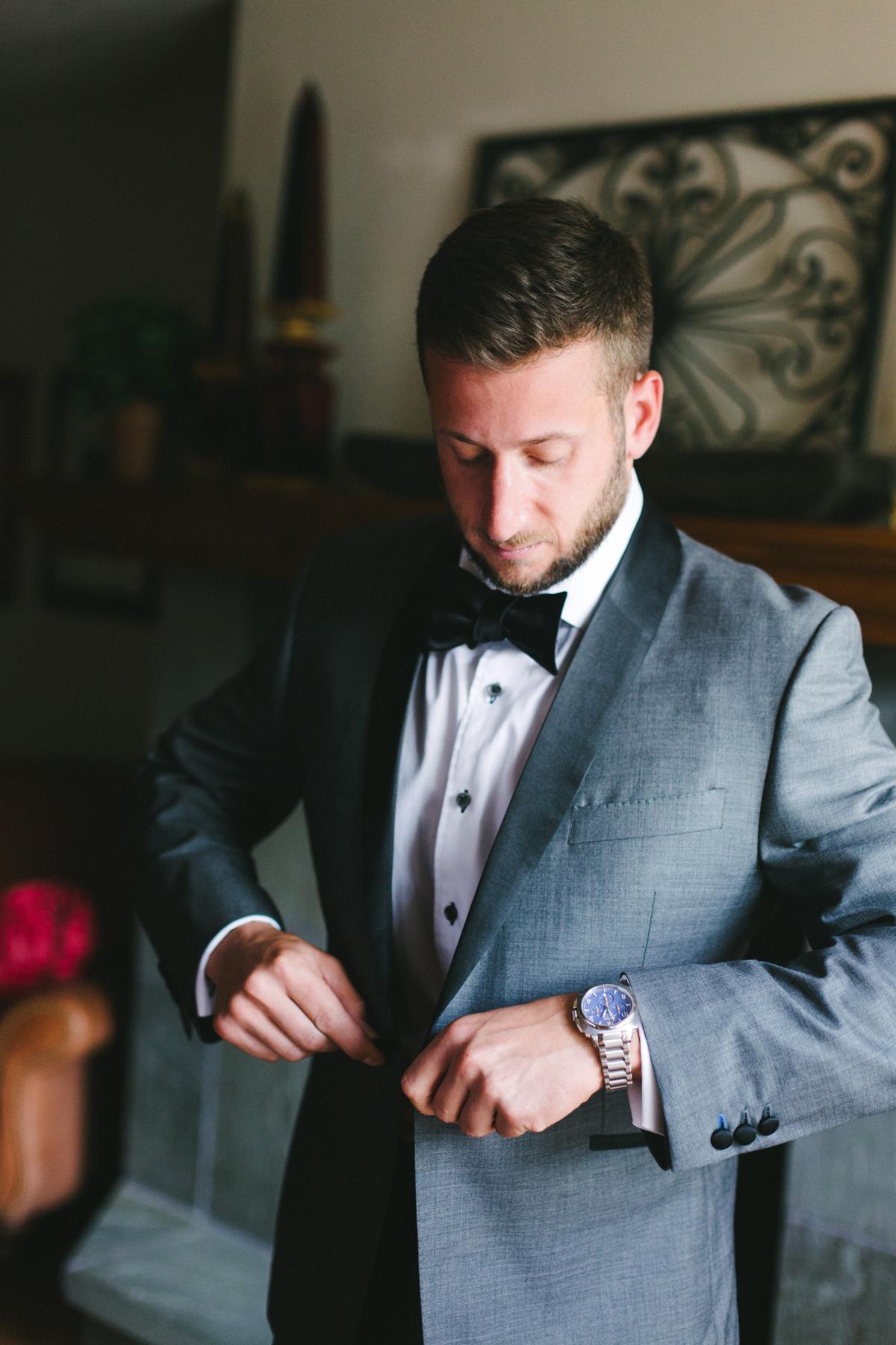 051-beaver-creek--groom-suit--wedding-photography--black-and-white--park-hyatt.jpg