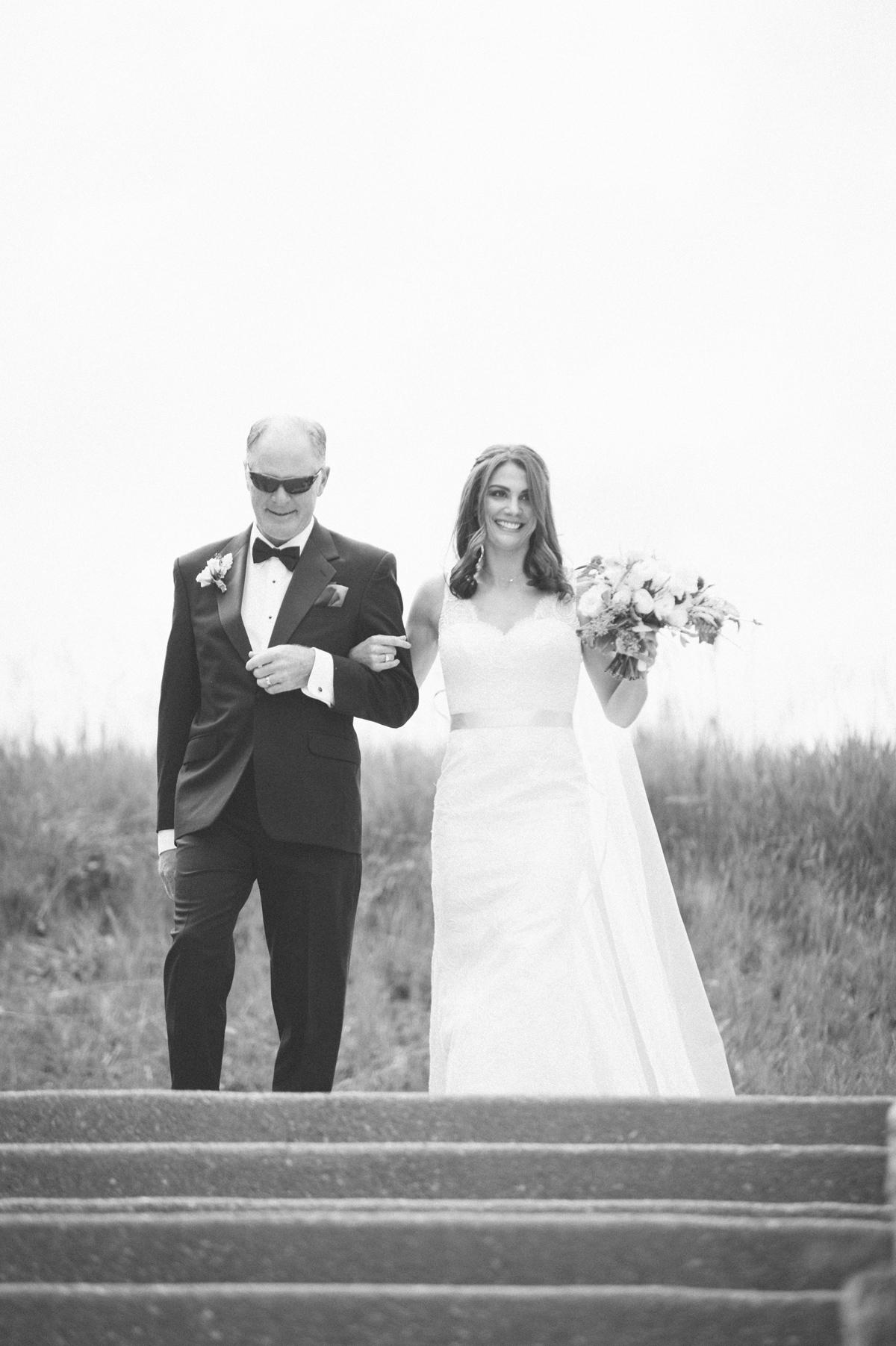 118-beaver-creek--bride--wedding-processional--dad--wedding--black-and-white.jpg