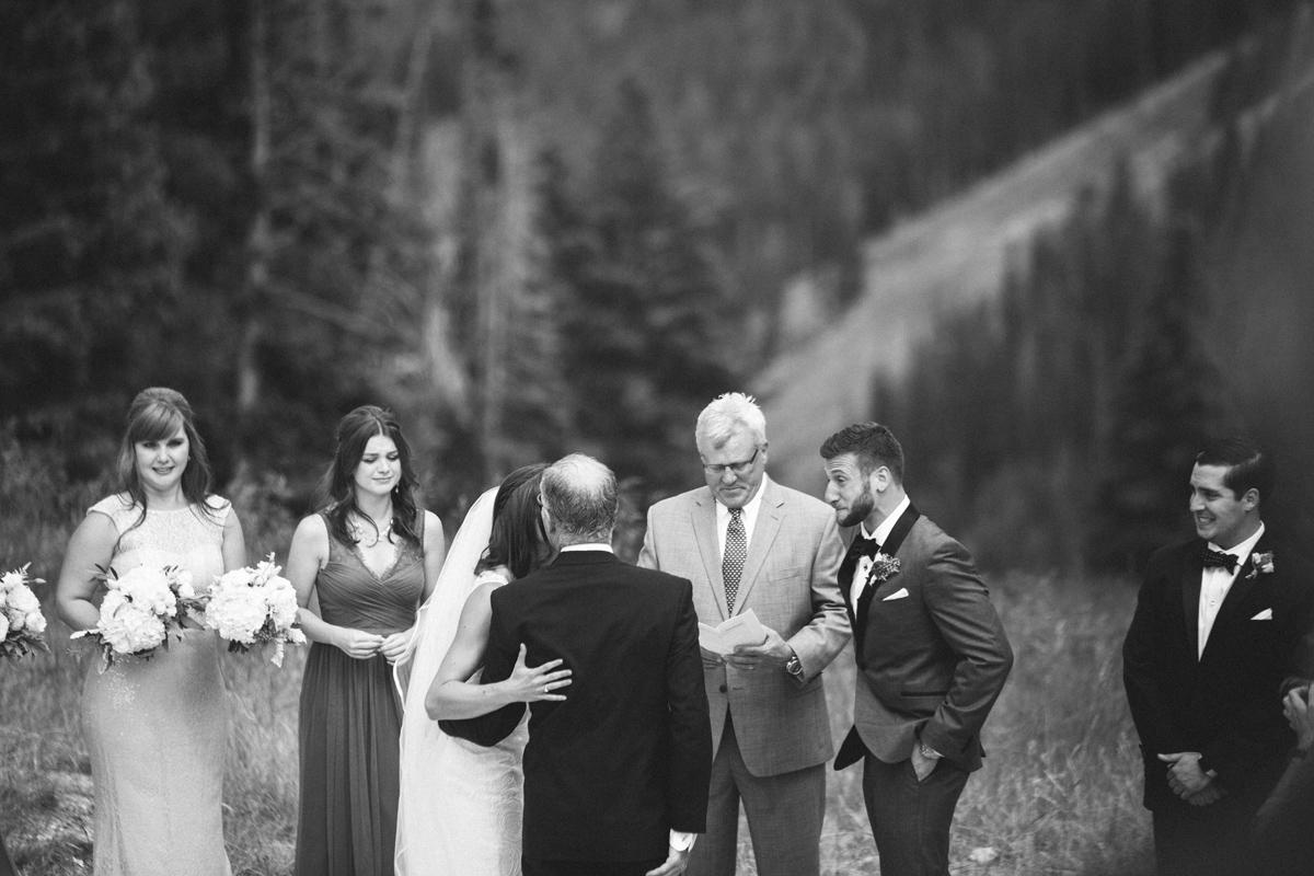 128-beaver-creek--bride--wedding-processional--dad--groom--emotional--black-and-white.jpg