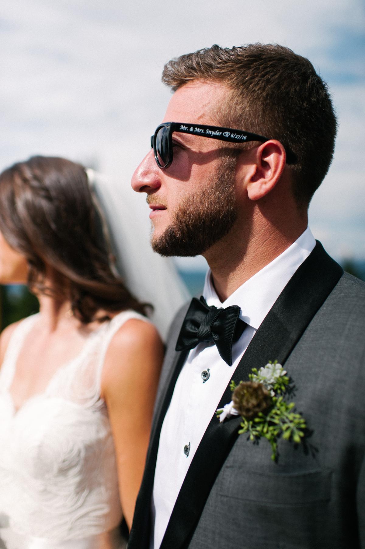 344-beaver-creek--mountain-top-wedding--groom--portrait--sunglasses.jpg