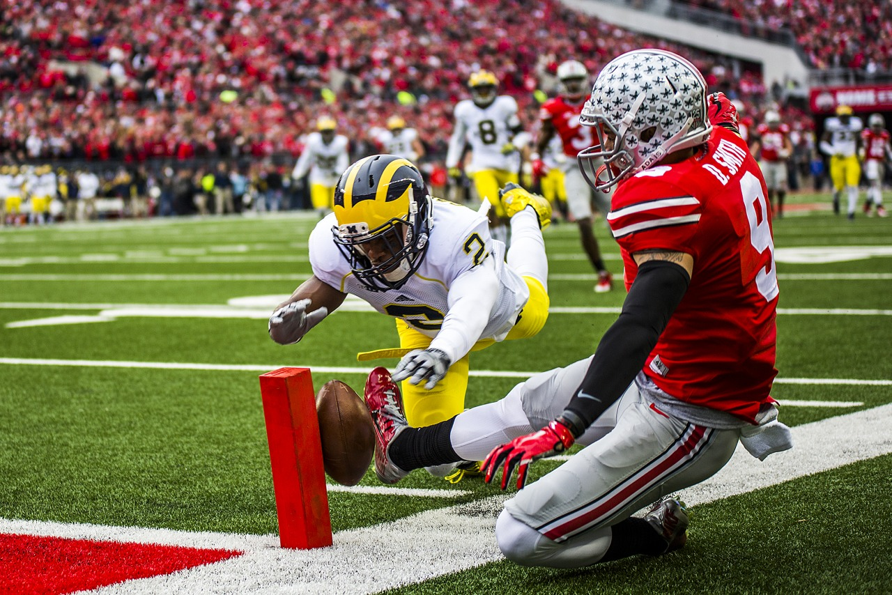Michigan cornerback Blake Countess and Ohio State wide receiver Devin Smith battle for a deep pass that fell beyond their reach during Michigan's game against Ohio State in Columbus on November 29, 2014.
