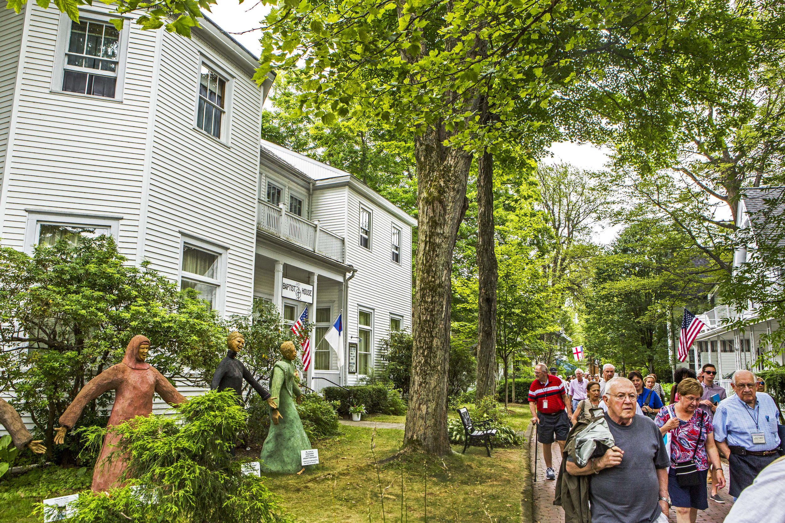 The Baptist House is located on the red brick walk along with a majority of the denominational houses in Chautauqua. Outside of their house are several colorful sculptures representing people of faith from different cultures.