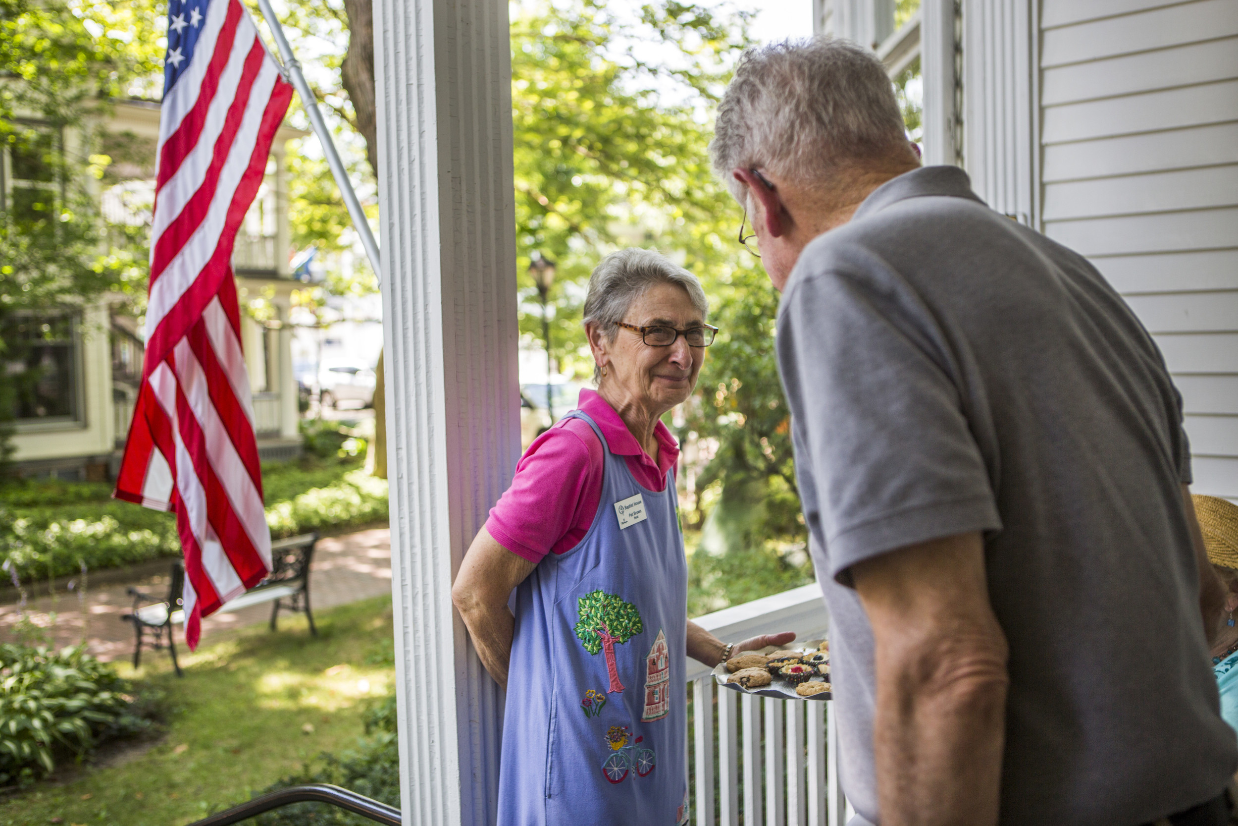 Pat and Bud share a quiet moment on the Baptist front porch during a Tuesday social hour. Bud says that when he first dropped Pat off in Chautauqua she cried because she didn't know anyone, but when Bud came to pick her up she cried because she didn't want to leave. Now Bud and Pat play important roles in the Chautauquan community.