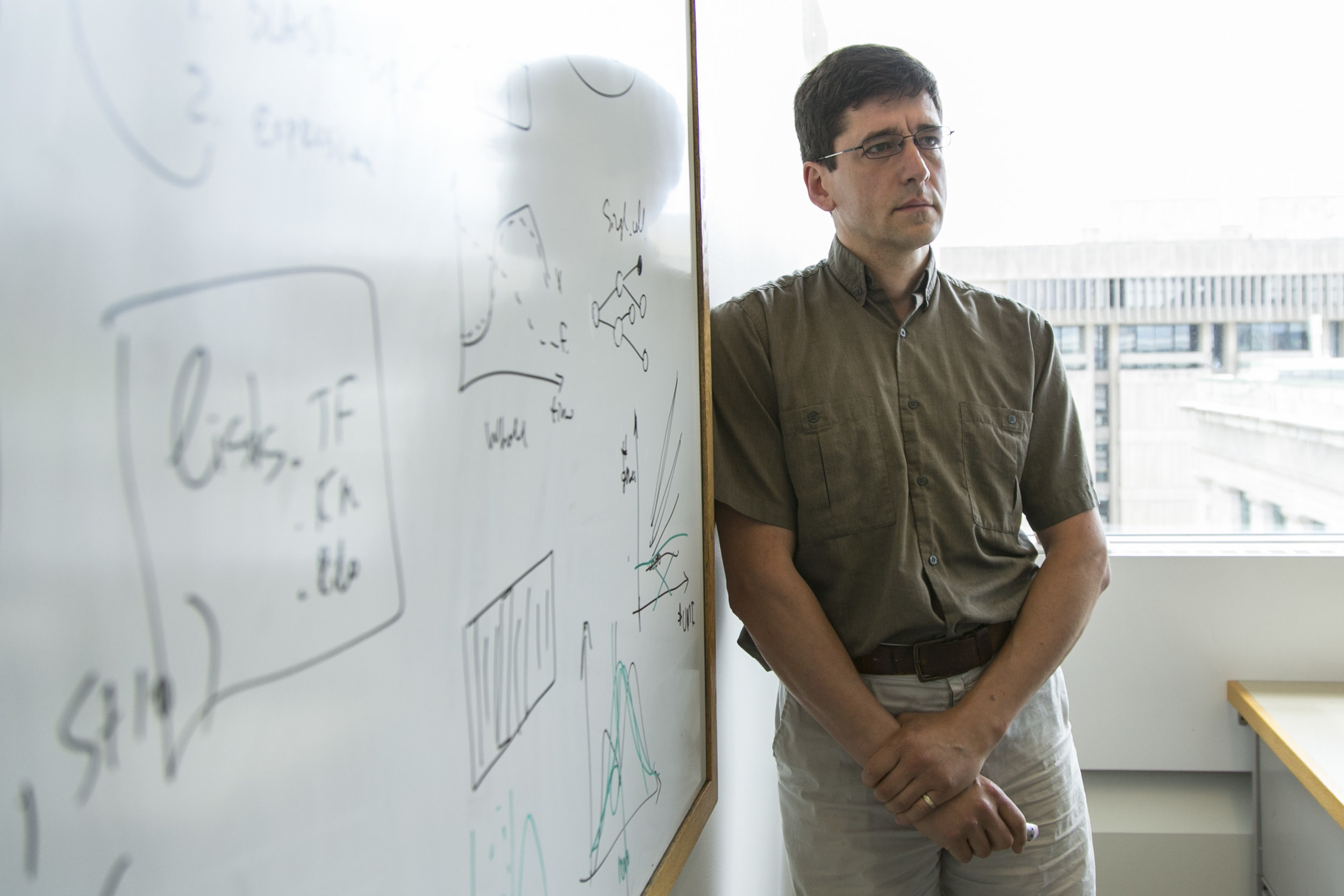 Harvard statistician and geneticist Leon Peshkin poses for a portrait in his office at Harvard Medical School on June 14, 2018. Peshkin's genome will become the reference for labs all over the world.