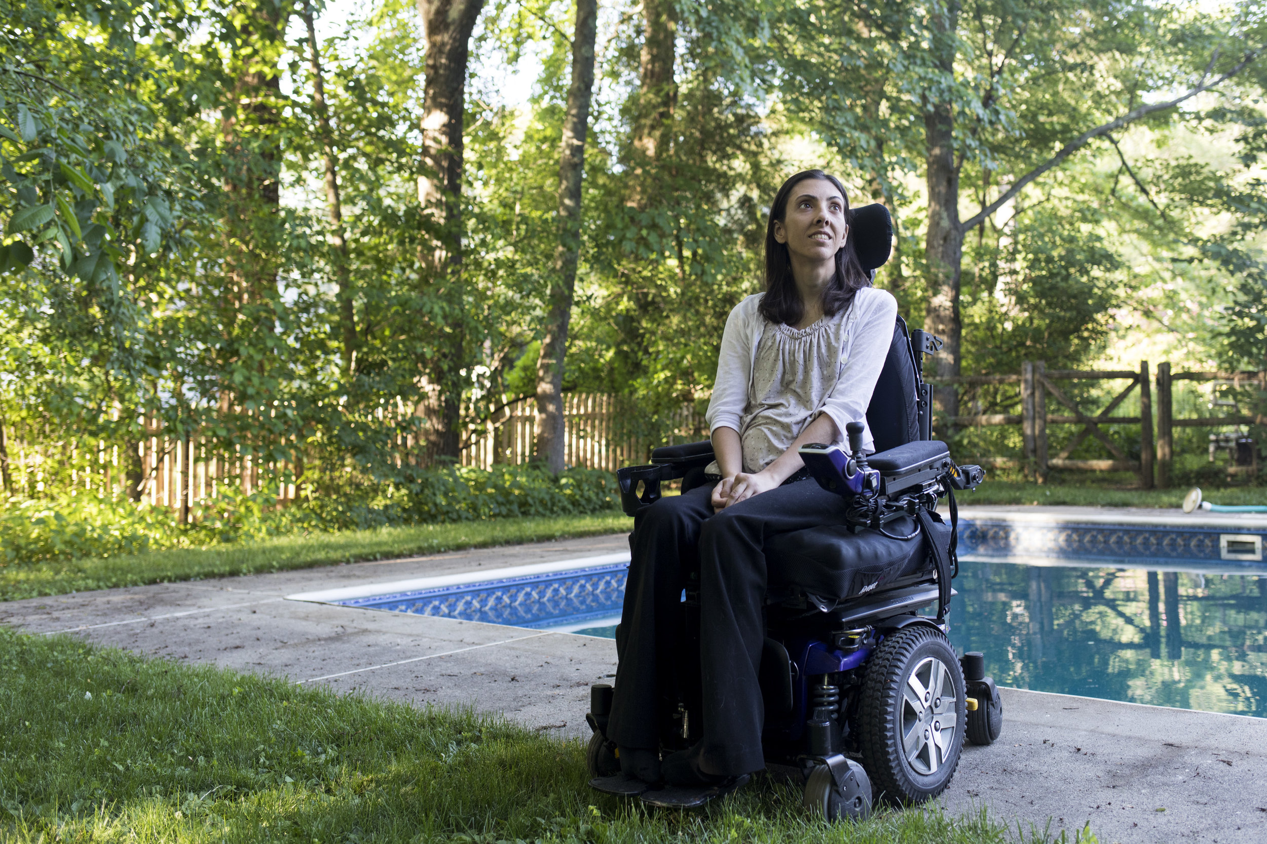 """Stephanie Zaia poses for a portrait at her home in Medfield on June 12, 2018. After years of her dystonia being misdiagnosed, Zaia met Dr. Alice Flaherty, a boundary breaking neurologist at Massachusetts General Hospital. """"She believed me,"""" said Zaia. """"She treated me like a human."""""""
